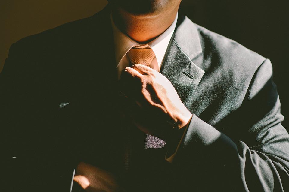 man holding his neck tie
