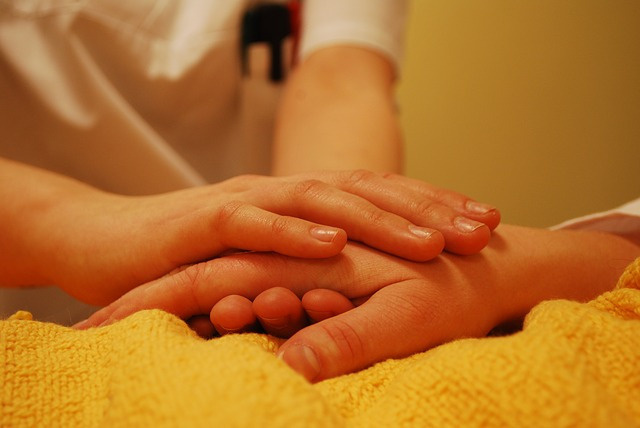 person holding patient hands