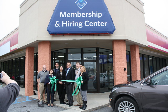 Cutting of ribbon in-front of a store
